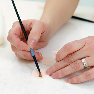 Meaghan paints edible glue on gum paste flower petals